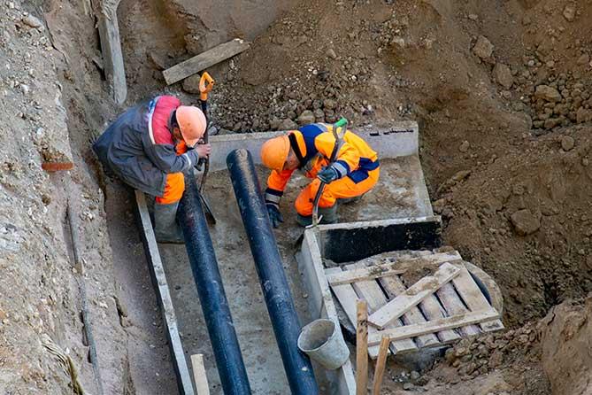 Завершен монтаж трубопровода: К концу недели улицу Коммунистическую откроют для движения